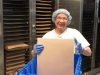 Sister Jacqui loading the baked sheets into the humidifying cabinet