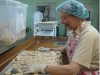 Sister Jacqui sorting peoples' breads