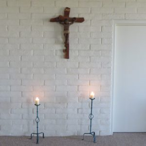 Crucifix with two candles burning in front of it