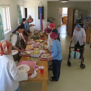 Sisters at the refectory serving table spread with picnic foods
