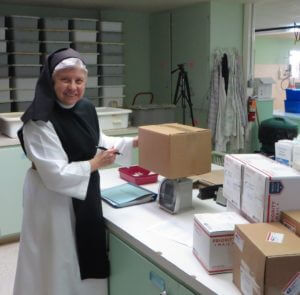 Sister Rita in the shipping department today