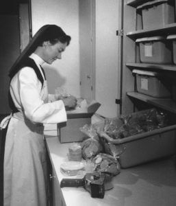 Sister Vicki in the 1980s preparing an order for shipment