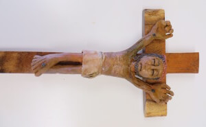Crucifix: clay corpus on mesquite wood